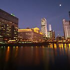 looking right down the chicago river at dusk by Sven Brogren