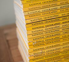National geographic magazines stacked by Greg Morris