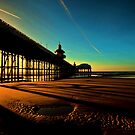 Shadows Of The Pier II by John Hare