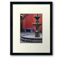 The Blue Bench, The Red Wall And A Green Fountain - El Banco Azul, El Muro Rojo Y Una Fontana Verde Framed Print