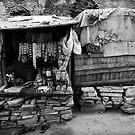 Shopkeeper in Street stall by Mark Smart