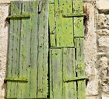 green shutters on stone building by Anne Scantlebury