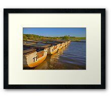 Boats in a loch Framed Print
