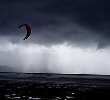 Atlantic storm approaches man with hand glider, Inch Beach Ireland by Grace Johnson