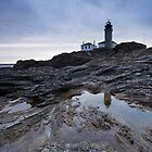 Beavertail Lightouse At Sunrise by Eric Full