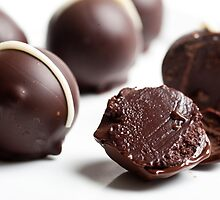 Dark Chocolate truffles on white background  by PhotoStock-Isra