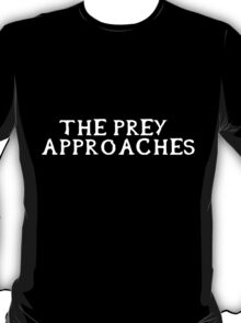 The prey approaches (White writing) T-Shirt