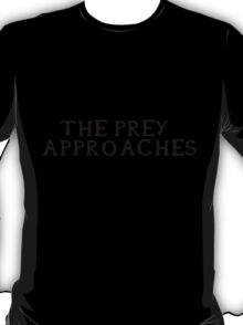 The prey approaches (Black writing) T-Shirt