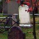 Ghostly Little Boy against a pole at the Sleepy Hollow Cemetery by Jane Neill-Hancock