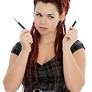Beautiful young woman with pen  by fotorobs