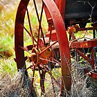 Rusty Wheel by Tracie Louise