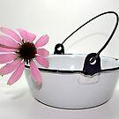 pink flower in enamel bowl by Lynne Prestebak