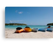 Kayaks on beach Canvas Print