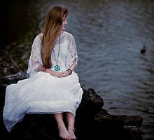 girl on the rocks with bird by kindsoflovely