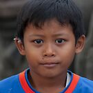 Balinese stonecutter's boy in Batubulan, Bali, Indonesia by Michael Brewer