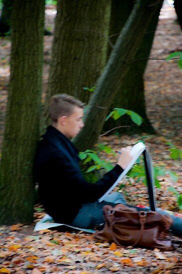 Young artist sketching in Middleheim Sculpture Park, Antwerp, Belgium by Michael Brewer