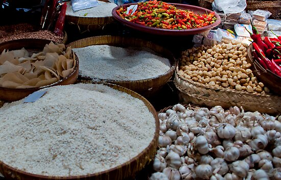 Rice and chilies for sale at the market in Amlapura in Bali, Indonesia by Michael Brewer