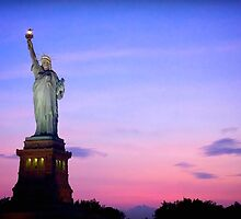 Sunset over Statue of Liberty by fernblacker