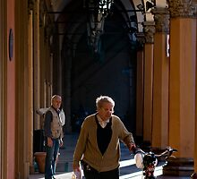 Walking the bicycle, Portico, Bologna, Italy by Andrew Jones