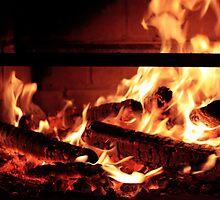 Cozy fire in a fireplace by EllieGoldwine