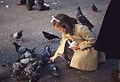 Girl feeding pigeons Trafalgar square 195709030006 by Fred Mitchell