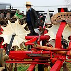 Amish Man and Farm Equipment by KellyHeaton