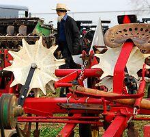 Amish Man and Farm Equipment by KellyHeaton