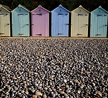 Colourful beach huts by nick pautrat