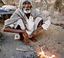 Man by fire by Mark Smart