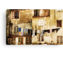 Drying laundry in mediterranean town. Canvas Print