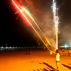 Fireworks on the beach at night by AdamRussell