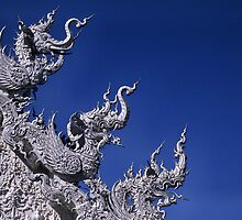 Three Naga heads, Wat Rung Khun Temple, Chiang Rai province, Thailand. by Phil Bower