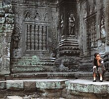 Ta Prohm guard. by Phil Bower