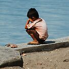 Boy at the river, West Bali by Michael Brewer