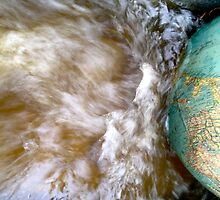 The World on a Globe in a River of Rainwater by carolinecollins