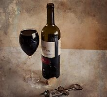 Wine glass and bottle by Janette Anderson