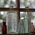 Old glass bottles by Sue McGlothlin