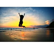 Woman jumping with joy on beach at sunset in Costa Rica Photographic Print