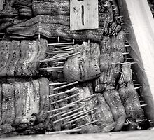 Unagi on a stick - Japan by Norman Repacholi