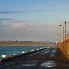 Breakwater aglow by Roger Neal