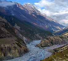 River and Clouds near Manang by SerenaB