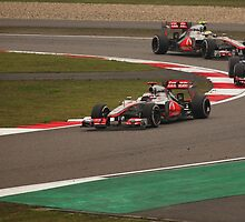 Hamilton and Button chase down and over take Mark Webber by Mark Bolton