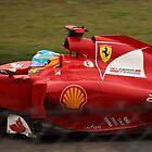 Fernando Alonso's Ferrari exits the pits by Mark Bolton