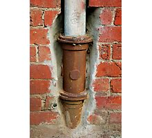 Rusty Down Pipe Framed in Red Brick Photographic Print