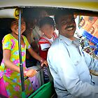 Family in Auto Rickshaw in Delhi, India by not-home.com - We Travel