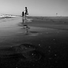 Footsteps in the sand by Zozzy-zebra