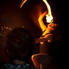 Fire breathing, fire eating on Shelly beach. by Alfred Kroese