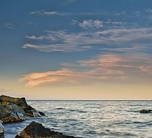 Lenticular clouds on the horizon by Andrea Rapisarda