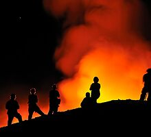 People watching lava flowing to the sea from Kilauea Volcano by Sami Sarkis