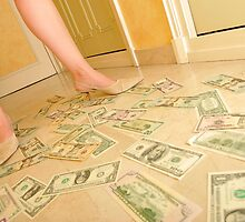 Woman's legs walking on Us dollars banknotes on floor. by Sami Sarkis